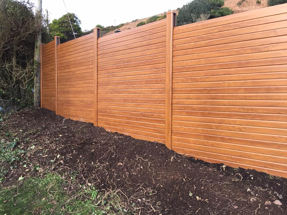 Golden oak upvc privacy fence